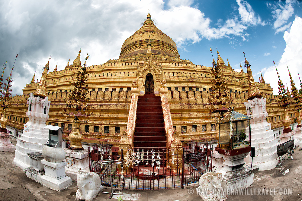 NYAUNG-U, Myanmar (Burma) - Built in the 11th century, Shwezigon Pagoda is located in Nyaung-U, near Bagan. From a large central gold leaf-guilded bell-shaped stupa radiate a number of smaller temples and shrines. The stupa is solid, and legend has it that it enshrines a bone and tooth of Gautama Buddha.