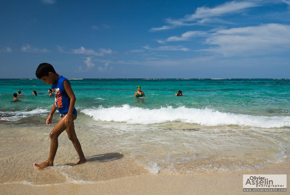 A boys walks down Maguana beach, near Baracoa, Cuba on Sunday July 13, 2008.