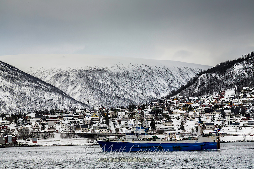 A snow covered small town nestled in the hills. (Photo by Travel Photographer Matt Considine)