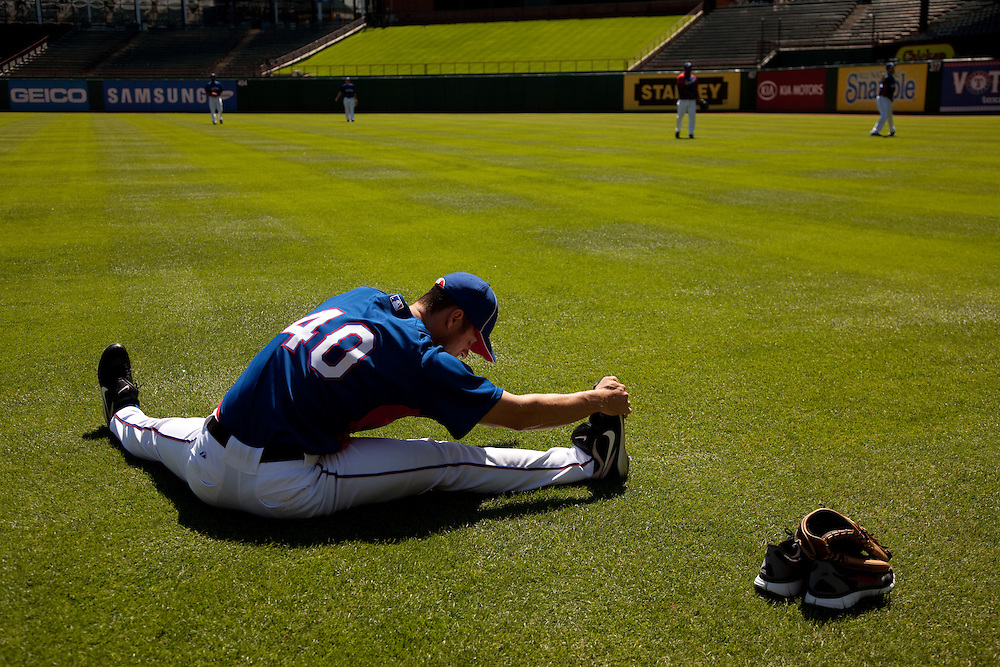 Rich Harden # 40 RHP, stretching pre-game. Detroit Tigers at Texas Rangers. Photographed at Rangers Ballpark in Arlington in Arlington, Texas on Sunday, April 26, 2010. Photograph © 2010 Darren Carroll