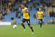 Oxford United midfielder Kemar Roofe (4) on the attack during the Sky Bet League 2 match between Oxford United and AFC Wimbledon at the Kassam Stadium, Oxford, England on 10 October 2015.