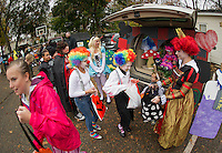 Brianna Baker and Piper Dion are greeted by Alice in Wonderland - the Benson family. Chelsea Read as Alice, Sherrie Benson as the Queen of Hearts and Sullivan as Rabbit and Ethan as Cheshire Cat during Holy Trinity's Trunk or Treat Halloween party.  (Karen Bobotas/for the Laconia Daily Sun)