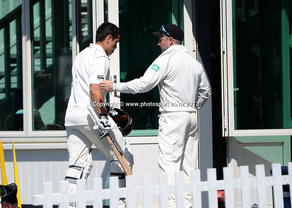 Ross Taylor heads back to the dressing room as Brendon McCullum looks on during play on Day 2 of the 1st cricket test match of the ANZ Test Series. New Zealand Black Caps v West Indies at University Oval in Dunedin. Wednesday 4 December 2013. Photo: Andrew Cornaga/www.Photosport.co.nz