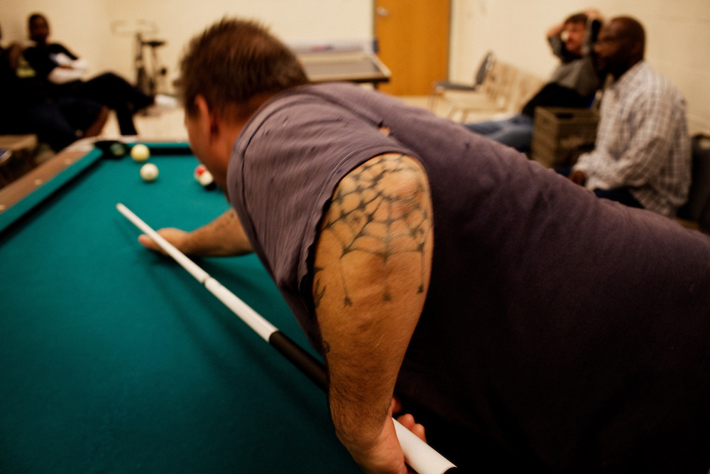 George Branham plays pool with other patients at Maryhaven, a healthcare facility specializing in treatment for people with alcohol and drug dependencies in Columbus, Ohio on Tuesday, April 21, 2009. Patients are kept on a very regimented schedule which includes time for recreational activities.