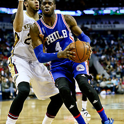 Feb 19, 2016; New Orleans, LA, USA; Philadelphia 76ers forward Nerlens Noel (4) drives past New Orleans Pelicans forward Anthony Davis (23) during the second half of a game at the Smoothie King Center. The Pelicans defeated the 76ers 121-114. Mandatory Credit: Derick E. Hingle-USA TODAY Sports