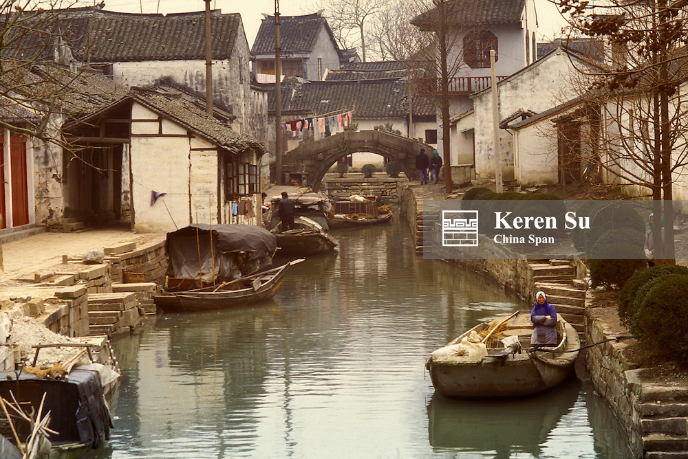 Traditional architecture with stone bridge along the Grand Canal, Suzhou, Jiangsu Province, China