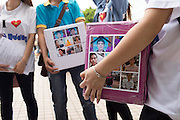July 12, 2015: Pictures of Vietnamese migrant workers hurt or killed in accidents while working in Taiwan encircle an image of Buddha on the collection boxes of Hội Từ Thiện Kết Nối Yêu Thương, a group of Vietnamese Kieu is in, who collect donations for these situations around Taiwan. The funds gathered by their group will go to help the families of these people.
