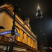 An exterior night shot of Grand Central Terminal showing the Chrysler Building in Manhattan, New York, USA. 29th January 2013. Photo Tim Clayton