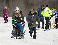 "Miss Lakes Region Kendall Wipff takes ""a one dog dash"" prior to the start of Sunday's Open race at Laconia's 85th annual World Championship Sled Dog Derby.  (Karen Bobotas/for the Laconia Daily Sun)"