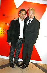 A party hosted by Mario Testino, Bianca Jagger and Kenneth Cole in collaboration with UNFPA and Marie Stopes International to celebrate the publication of Women to Woman: Positively Speaking - a book to raise awareness of women living with HIV/Aids, held at The Orangery, Kensington Palace, London on 2nd December 2004.<br />Picture shows Left to right, designer KENNETH COLE and photographer MARIO TESTINO.<br /><br />NON EXCLUSIVE - WORLD RIGHTS