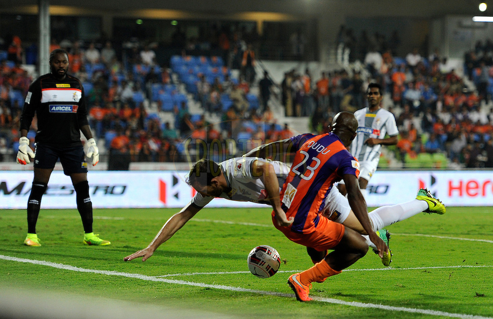 Jose Miguel Gonzalez Rey of Atletico de Kolkata and MacPherlin Dudu Omagbemi of FC Pune City in action during match 44 of the Hero Indian Super League between FC Pune City and Atletico de Kolkata FC held at the Shree Shiv Chhatrapati Sports Complex Stadium, Pune, India on the 29th November 2014.<br /> <br /> Photo by:  Pal Pillai/ ISL/ SPORTZPICS