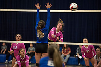 Interlakes Emma Wheeler powers a spike past Winnisquam's Madison Skeats during NHIAA DIvision III volleyball on Wednesday evening.  (Karen Bobotas/for the Laconia Daily Sun)