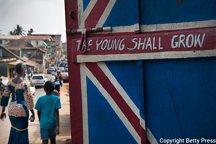 The Young Shall Grow in UK colors written on shop door.