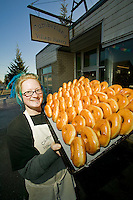 Local residents can often be seen waiting outside the doors of the Cumberland bakery waiting for the freshly made doughnuts that the bakery is famous for.  Cumberland, Vancouver Island, British Columbia, Canada.