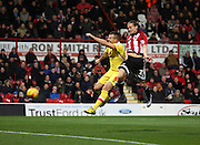 Brentford striker Lasse Vibe beating Milton Keynes Dons defender Antony Kay to score the first goal during the Sky Bet Championship match between Brentford and Milton Keynes Dons at Griffin Park, London, England on 5 December 2015. Photo by Matthew Redman.
