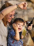 Photo by Gary Cosby Jr.  Two year old Noah Cottles reacts to a fish he and his mom Vanessa Cottles have just caught while fishing at Cowford Landing Friday.