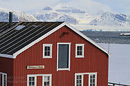 Mellageret Kafe, once a flour warehouse, stands on outskirts of the international science village of Ny-Alesund amid April snows on Spitsbergen island in Kongsfjorden; Svalbard, Norway.