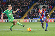 Crystal Palace defender Pape Souare  goes past Sunderland midfielder Sebastian Larsson during the Barclays Premier League match between Crystal Palace and Sunderland at Selhurst Park, London, England on 23 November 2015. Photo by Simon Davies.