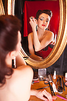 Showgirl applying eye shadow