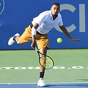 NICK KYRGIOS hits a serve at the Rock Creek Tennis Center.