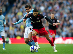 MANCHESTER, ENGLAND - Sunday, March 13, 2011: Manchester City's Carlos Tevez and Reading's Jobi McAnuff during the FA Cup 6th Round match at the City of Manchester Stadium. (Photo by David Rawcliffe/Propaganda)