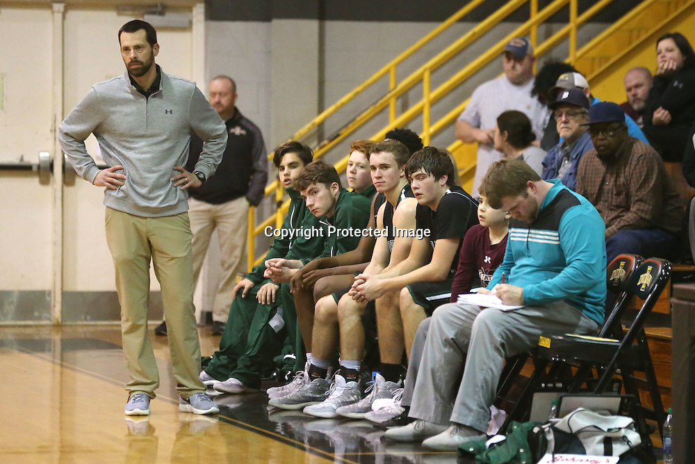 Lauren Wood | Buy at photos.djournal.com<br /> Mooreville boy's basketball head coach Jim Tally watches the game from the sidelines during Tuesday night's game at IAHS.