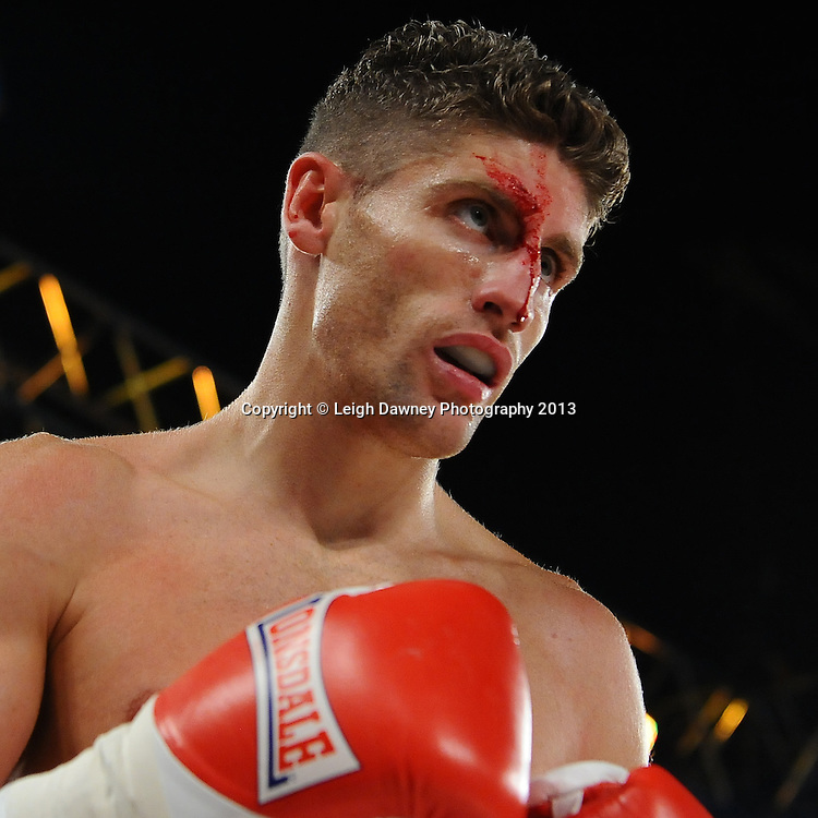 Leo D'Erlanger  with cut above his right eye during a boxing contest against Muheeb Fazeldin on Saturday 14th September 2013 at the Magna Centre, Rotherham. Hennessy Sports. Self billing applies. © Credit: Leigh Dawney Photography.