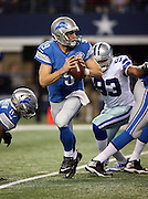 Detroit Lions quarterback Matthew Stafford (9) gets flushed out of the pocket by Dallas Cowboys defensive end Anthony Spencer (93) and throws a fourth quarter pass that gets batted down by a lineman during the NFL week 18 NFC Wild Card postseason football game against the Dallas Cowboys on Sunday, Jan. 4, 2015 in Arlington, Texas. The Cowboys won the game 24-20. ©Paul Anthony Spinelli