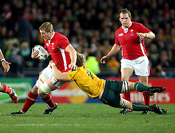 © SPORTZPICS/ Seconds Left Images 2011 - Wales' Bradley Davies is caught by Australia's David Pocock - Wales v Australia - Rugby World Cup 2011 - Bronze Final - Eden Park - Auckland - New Zealand - 21/10/2011 -  All rights reserved..