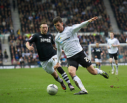 DERBY, ENGLAND - Saturday, March 12, 2011: Derby County's Daniel Ayala in action against Swansea City's Stephen Dobbie during the Football League Championship match at Pride Park. (Photo by David Rawcliffe/Propaganda)