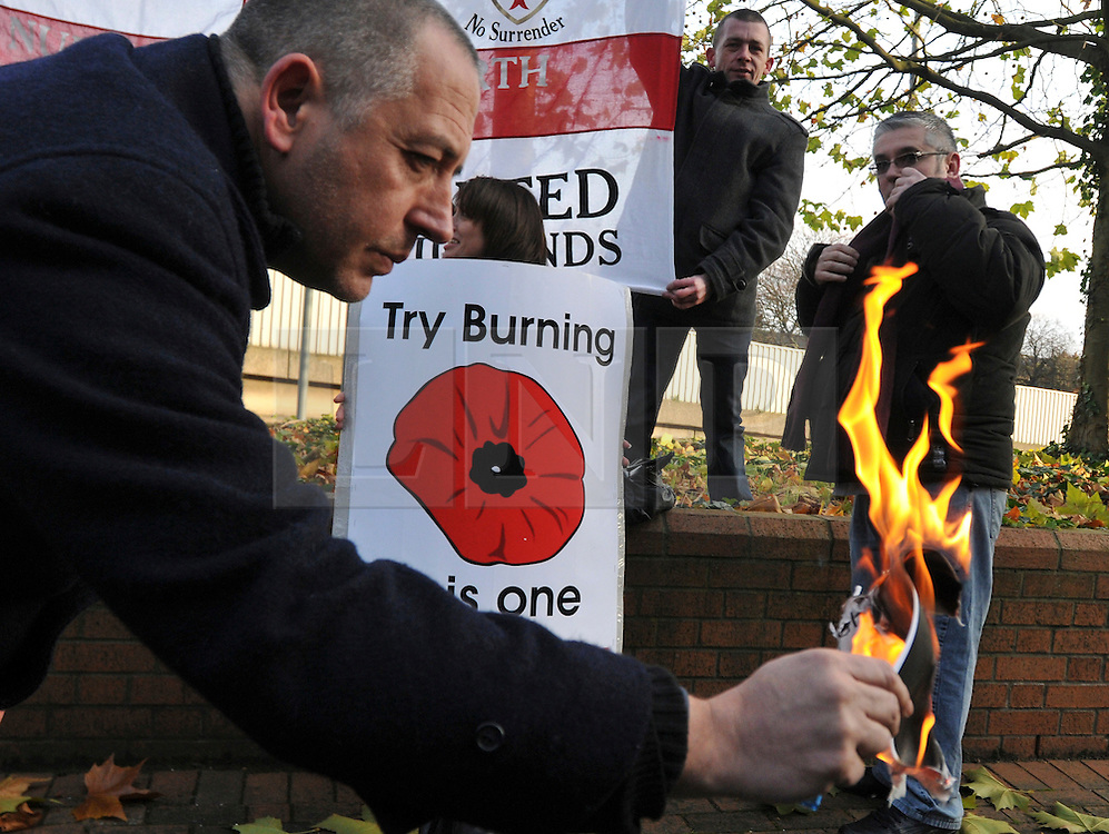 © under license to London News Pictures. 22/11/2010. A man burns a photocopy of The Rayah, an Islamic Flag. English Defence League founder Stephen Lennon appears in court today (Monday) in West London accused of assaulting a police officer on the anniversary of Armistice Day. Lennon was arrested during a counter protest against a hardline Islamic group. Photo credit should read: Stephen Simpson/LNP