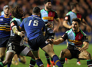 Marland Yarde ( L ) and George Lowe ( R ) of Harlequins tackle Zane Kirchner of Leinster during the European Rugby Champions Cup match at Twickenham Stoop , London<br /> Picture by Paul Terry/Focus Images Ltd +44 7545 642257<br /> 07/12/2014