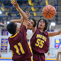 Valley Sanders Pirate Apollo Smith (10) and Rough Rock Sun Devil Devin Smith (55) compete for a rebound Wednesday at Valley Sanders High School.