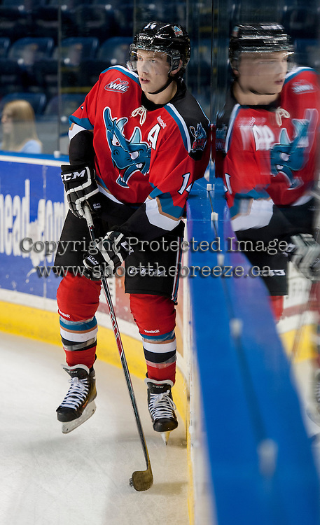 KELOWNA, CANADA - AUGUST 30: Rourke Chartier #14 of the Kelowna Rockets handles the puck during warm up against the Kamloops Blazers on August 30, 2014 during pre-season at Prospera Place in Kelowna, British Columbia, Canada.   (Photo by Marissa Baecker/Shoot the Breeze)  *** Local Caption *** Rourke Chartier;