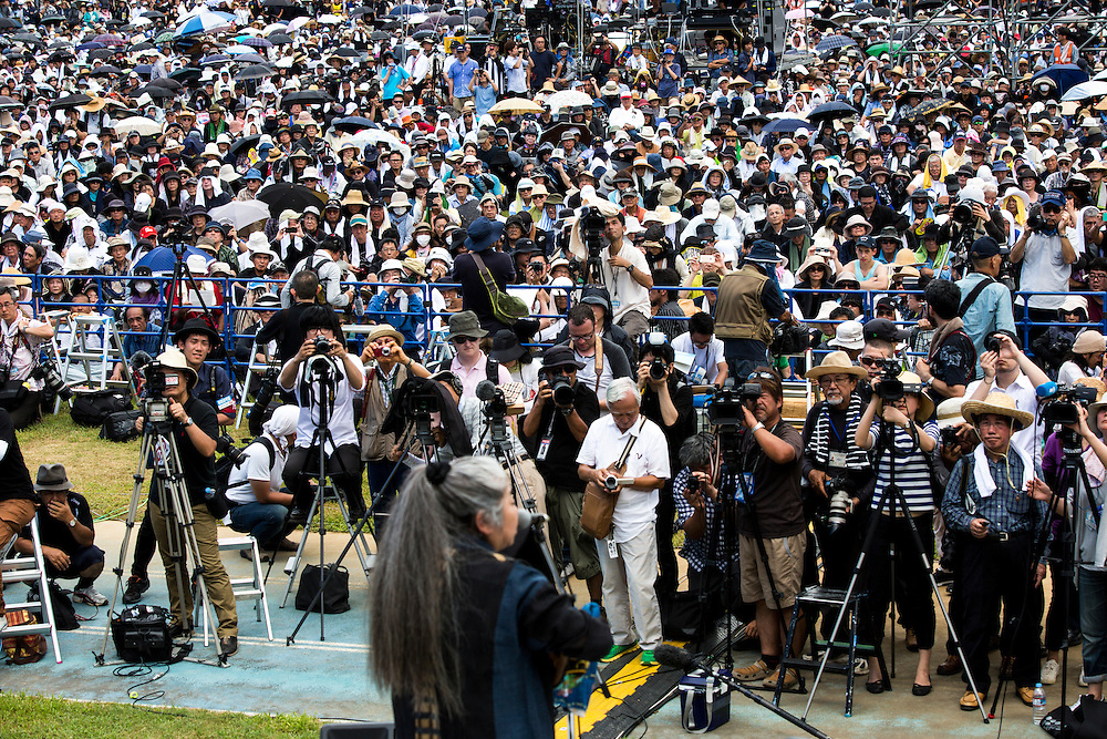 OKINAWA, JAPAN - JUNE 19 : Thousands of people spend a moment of silence to pray for the Japanese rape victim at Henoko at Ohnoyama General Athletic Field at the Ohnoyoma Park and sports complex in central Naha, Okinawa on June 19, 2016. Around 65,000 people gathered at the rally, protests have grown more intense in the past days due to the past incident of rape of a Japanese woman and drunk driving in Okinawa over American military presence in Japan. Photo: Richard Atrero de Guzman