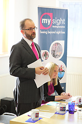 Chair of Mysight charity presenting their new branding to a meeting.