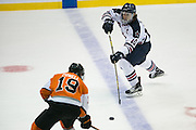 Robert Morris defenseman Tyson Wilson skates with the puck during the Atlantic Hockey final against RIT at the Blue Cross Arena in Rochester on Saturday, March 19, 2016.