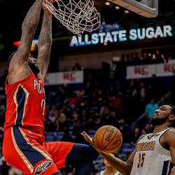 Dec 6, 2017; New Orleans, LA, USA; New Orleans Pelicans center DeMarcus Cousins (0) dunks over Denver Nuggets forward Kenneth Faried (35) and forward Wilson Chandler (21) during the second half at the Smoothie King Center. The Pelicans defeated the Nuggets 123-114. Mandatory Credit: Derick E. Hingle-USA TODAY Sports