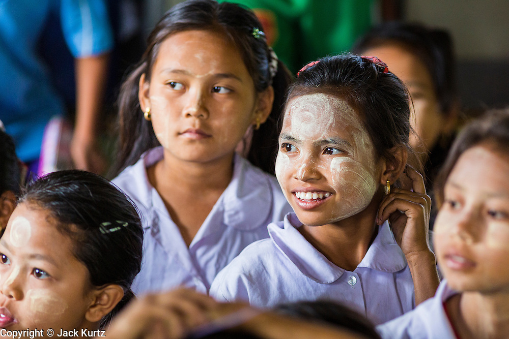 04 MARCH 2014 - MAE SOT, TAK, THAILAND: Burmese girls with traditional thanaka powder on their faces at the Sky Blue School in Mae Sot. There are approximately 140 students in the Sky Blue School, north of Mae Sot. The school is next to the main landfill for Mae Sot and serves the children of the people who work in the landfill. The school relies on grants and donations from Non Governmental Organizations (NGOs). Reforms in Myanmar have alllowed NGOs to operate in Myanmar, as a result many NGOs are shifting resources to operations in Myanmar, leaving Burmese migrants and refugees in Thailand vulnerable. The Sky Blue School was not able to pay its teachers for three months during the current school year because money promised by a NGO wasn't delivered when the NGO started to support schools in Burma. The school got an emergency grant from the Burma Migrant Teachers' Association and has since been able to pay the teachers.    PHOTO BY JACK KURTZ