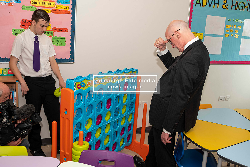 Pictured: John Swinney took up[ the challenge of connect four thrown down by Kieran McKenzie (S5).  Mr Swinney was glad he won.<br /><br />The Deputy First Minister visited Holy Rood High School in Edinburgh today to meet parents and pupils before announcing GBP50 million funding for improving attainment.  The results of a survey of headteachers were also published during the Deputy First Minister's visit.<br /><br /> Ger Harley   EEm 30 May 2019
