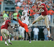 10-20-07 AL DIAZ / MIAMI HERALD STAFF--. AL DIAZ / MIAMI HERALD STAFF--the University of Miami vs Florida State at Doak Campbell Stadium on Saturday.<br /> <br /> FSU's Anthony Houllis (46) intercepts a pass in the third quarter intended for UM's Shawnbrey McNeal (33).<br /> Miami Herald Photo by Al Diaz