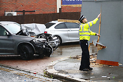 © Licensed to London News Pictures. 14/07/2019. London, UK. A crashed BMW X5 car remains near Lombard Road in Battersea, south west London after a car was driven into a group of people leaving a hotel. Three men have been arrested on suspicion of murder after the incident which took place at 11. 15pm on Saturday night. One man has a broken leg and six other people also sustained minor injuries. Photo credit: Peter Macdiarmid/LNP