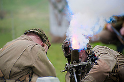 Reenactors portraying US paratroopers from the 82nd Airborne crews a Mortar during a battle reenactment at Fort Paull Monday.7 May 2012.Image © Paul David Drabblee
