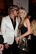 PETER DUNDAS;  POPPY DELEVIGNE, Harper's Bazaar Women Of the Year Awards 2011. Claridges. Brook St. London. 8 November 2011. <br /> <br />  , -DO NOT ARCHIVE-© Copyright Photograph by Dafydd Jones. 248 Clapham Rd. London SW9 0PZ. Tel 0207 820 0771. www.dafjones.com.