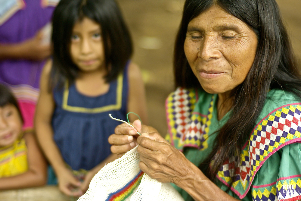 Indigenous Ngo?be Bugle? old woman sewing.  Chiriqui. Panama.