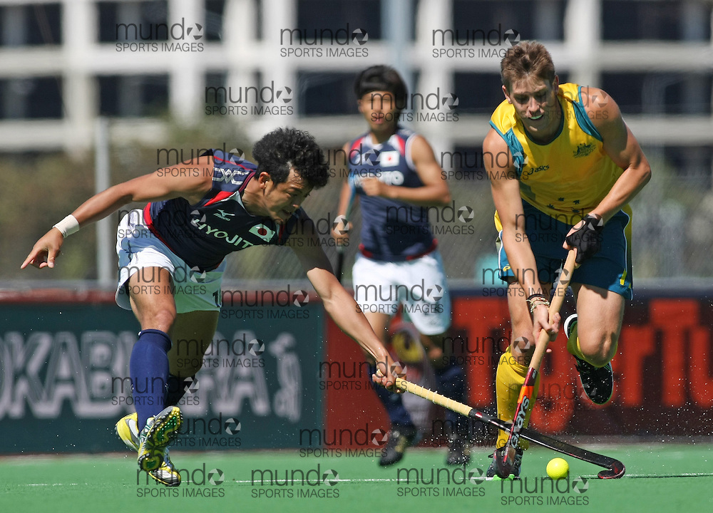 (Canberra, Australia---31 March 2012) Eddie Ockenden of the Australia Kookaburra national field hockey team and Yoshihiro Anai of Japan playing the second of a three game field hockey test match series between Australia and Japan men's field hockey teams. 2012 Copyright Photograph Sean Burges / Mundo Sport Images.