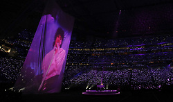 February 4, 2018 - Minneapolis, MN, USA - Justin Timberlake pays tribute to Prince, singing ''I Would Die 4 U,'' as video of the music icon performing in ''Purple Rain'' is projected on a large screen during the Super Bowl halftime show Sunday, Feb. 4, 2018 in Minneapolis, Minn. (Credit Image: © Carlos Gonzalez/TNS via ZUMA Wire)