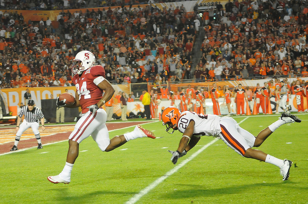 January 3, 2011: Jeremy Stewart of the Stanford Cardinal runs past Jayron Hosley of the Virginia Tech Hokies for a touchdown during the NCAA football game between the Stanford Cardinal and the Virginia Tech Hokies at the 2011 Orange Bowl in Miami Gardens, Florida. Stanford led Virginia Tech 13-12 at the half.