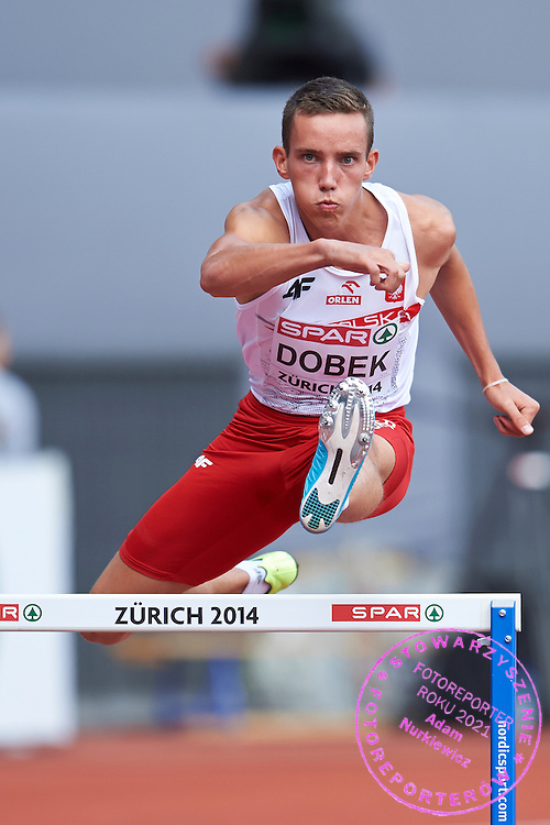 Patryk Dobek from Poland competes in men's 400 meters hurdles qualification during the First Day of the European Athletics Championships Zurich 2014 at Letzigrund Stadium in Zurich, Switzerland.<br /> <br /> Switzerland, Zurich, August 12, 2014<br /> <br /> Picture also available in RAW (NEF) or TIFF format on special request.<br /> <br /> For editorial use only. Any commercial or promotional use requires permission.<br /> <br /> Photo by &copy; Adam Nurkiewicz / Mediasport