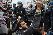 ITALY, GIUGLIANO : Riot police scatter demonstrators that block the road to the Taverna del Re dump in Giugliano on November 2, 2010. Demonstrators protest against the re-opening of the Taverna del Re dump taht contains more than six milion tons of garbage. AFP PHOTO / ROBERTO SALOMONE